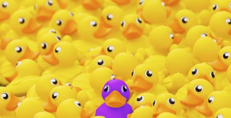 purple duck in a sea of yellow ducks show customized financial planning solutions | Sheaff Brock